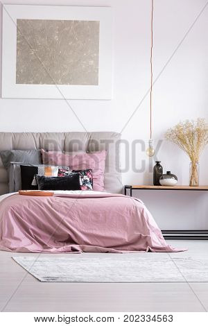 Pink Bedsheets On King-size Bed