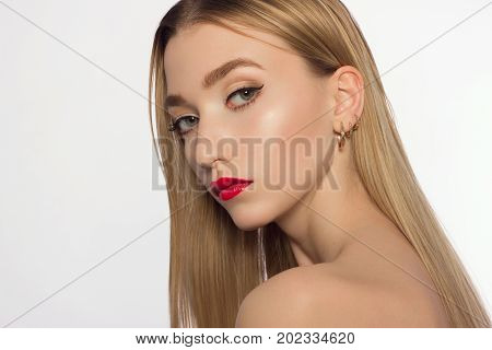 Person of model of fashion beauty. The magnificent beauty the blonde with a classical make-up. Red lips black shooters and white opaque skin. Long neck and pure leather. Cosmetology beauty shop