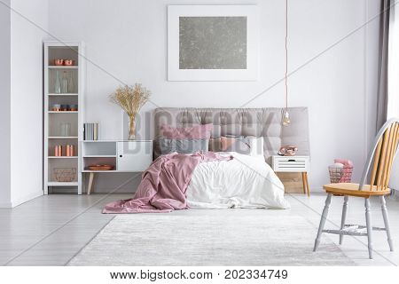 Orange Chair In Bright Bedroom