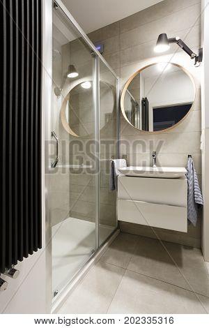 Modern Bathroom With Beige Tiles