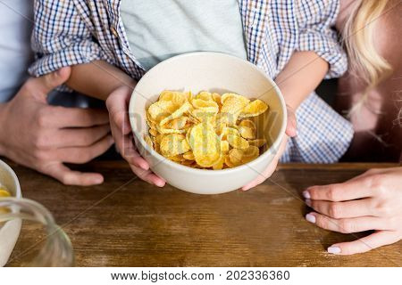 Family With Corn Flakes