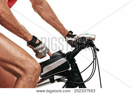 male sportsman clicks on a smartphone in a bag of modern bike. white background