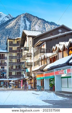 Chamonix, France - January , 30, 2015:  Spar Store in Chamonix town in French Alps, France and mountains at the background