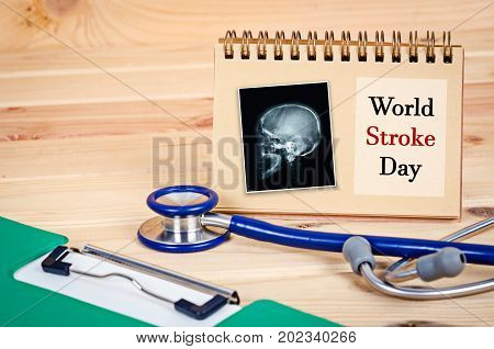 World Stroke Day and x ray of skull or head human with stethoscope medical and document file.