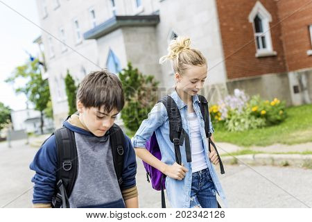 A Portrait of school 10 years boy and girl having fun outside