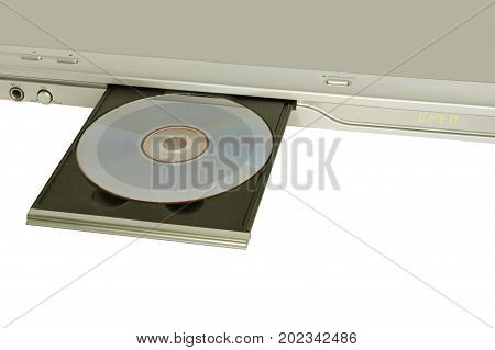 CD player with inserted disc taken closeup on white background.