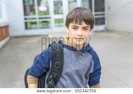 A Nice Pre-teen boy outside at school having good time