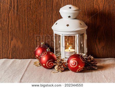 Christmas lantern and christmas balls and cones. Selective focus