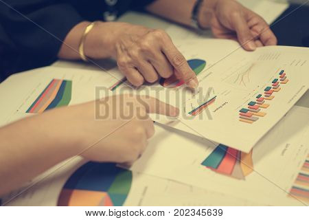 Old Business Women On Discussion Analysis Business Goal On Business Document Data With Young Busines