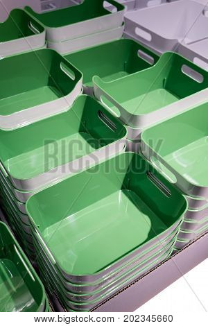 Stack of green plastic trays arrangement for background. Multi-purpose kitchenware collection