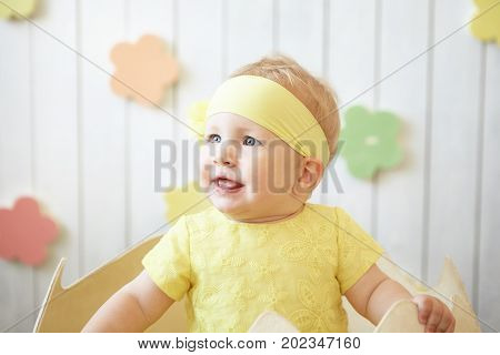 photo of little girl in yellow dress i the eggshell