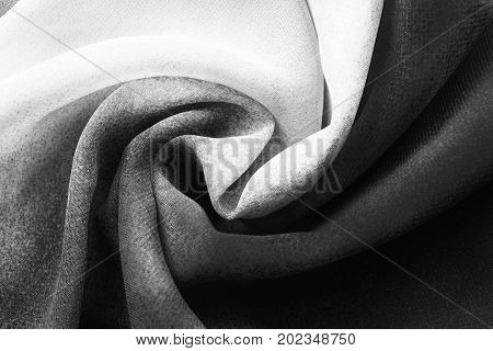 Black and white draped silk closeup as a background