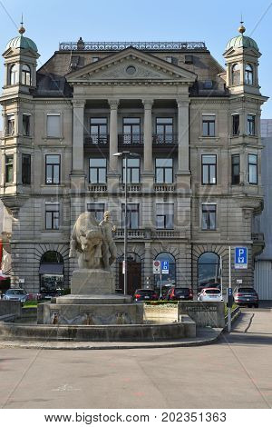 Zurich Switzerland - June 14 2017: Burkliplatz square and Public Monumental Fountain better known as Geiserbrunnen or Bull from the Sea sculptor Jakob Brulmann. Was inaugurated on 20 October 1911