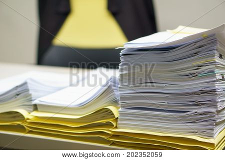 Pile Of Organized But Unfinished Business Documents On Desk In The Office,  Business And Job Concept
