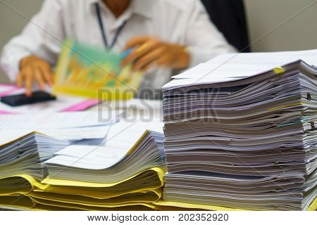 Pile Of Unfinished Business Document On The Executive Business Man Desk While Working In The Office.