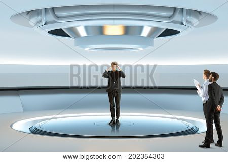 Pensive man trying to teleport with curious businessmen watching him. Experiment concept future and innovation. 3D Rendering poster