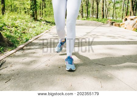 Jogging And Running Woman With Athletic Legs On Jog Or Run In Healthy Lifestyle Concept With Close U