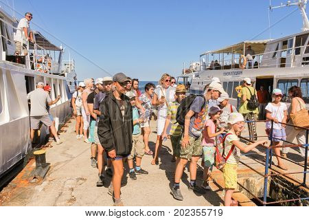 Yalta, Crimea - 11 July, Tourists coming off the ship, 11 July, 2017. Small Castle Lastochkino Nest and its surroundings.