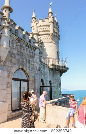 Yalta, Crimea - 11 July, People at the castle, 11 July, 2017. Small Castle Lastochkino Nest and its surroundings.