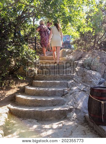 Yalta, Crimea - 11 July, Stone staircase with semi-circular steps, 11 July, 2017. Small Castle Lastochkino Nest and its surroundings.