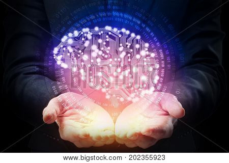 Businessman hands holding abstract circuit brain on dark background. Artificial intelligence concept