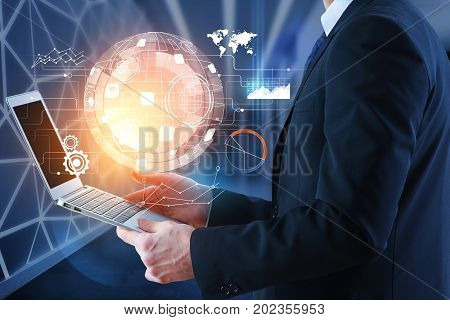 Side view of young businessman using laptop with abstract futuristic business projection on blurry interior background. Future and innovation concept. 3D Rendering