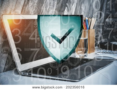Close up of digital antivirus shield and digits at workplace with laptop supplies and other items. Future concept. Double exposure