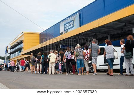 MAGDEBURG, GERMANY - AUGUST 31, 2017: Visitors in front of the new Ikea branch in Magdeburg, just a few minutes before the opening.