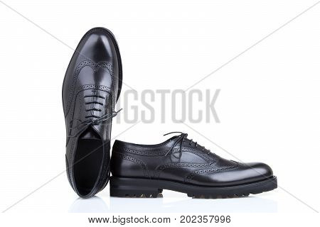 Pair of male derby shoes in black color