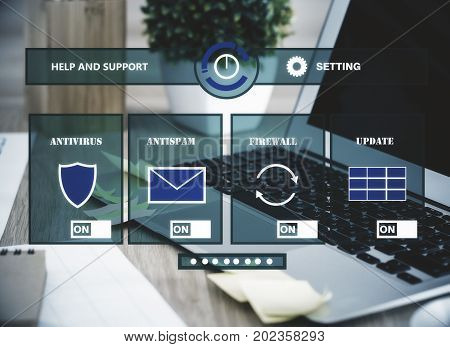 Modern workplace with laptop blurry plant other items and antivirus interface. Safety concept