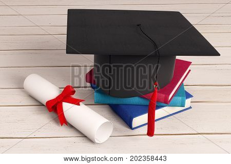 Mortarboard book and paper roll on wooden surface. Education concept. 3D Rendering