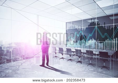 Back view of young businessman talking on the phone in modern meeting room interior with forex chart. Strategy concept. Double exposure