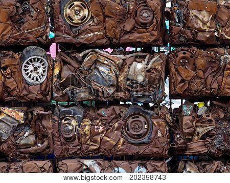 Crushed metal car blocks in a scrapyard