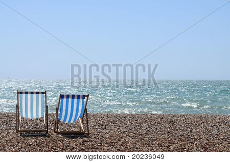 stripy chairs on the beach