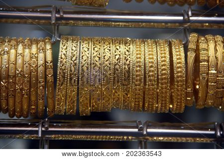 Precious gold bangles made in ethnic delicate designs and patterns