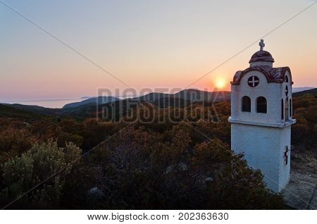 Small church or chapel with typical Greek landscape at sunset in Sithonia, Greece