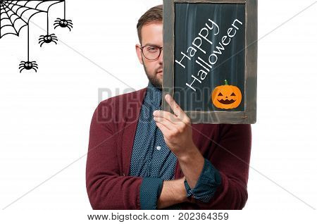 Man Holding Chalkboard With Text  Happy Halloween.
