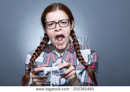 Nerd Woman with Braid Playing Videogames with a Joypad