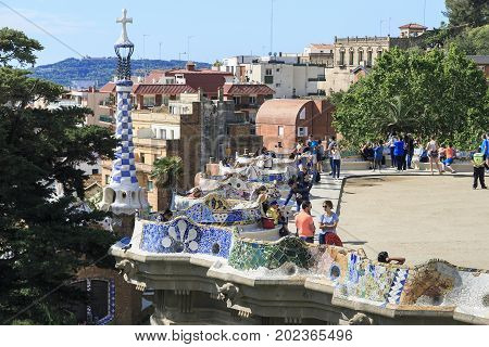 BARCELONA, SPAIN - MAY 13, 2017: This is a serpentine bench on Nature Square in Guell Park.