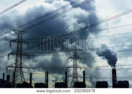 High Voltage 500 Kv Transmission Line And Pylon With Coal Fire Power Plant Release Steam From Stack