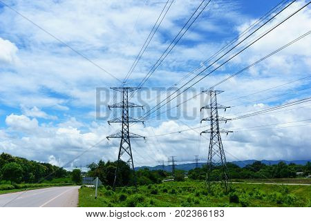 500 Kv Transmission Line In Maemoh Lampang Thailand. Electricity Transmission Pylon With Blue Sky An