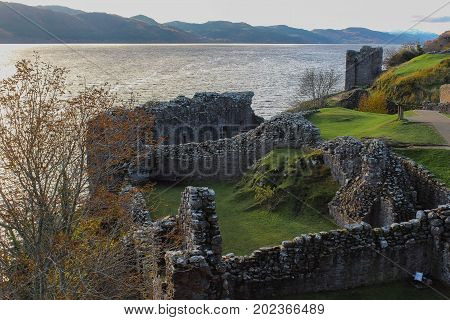 Birds eye view of the ruins of Urquhart Castle and Loch Ness in the Autumn.