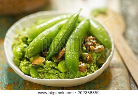 Edamame, soybeans, sugar snap peas, spinach, lemon roasted seeds with pea dip