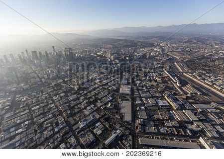 Aerial view above Alameda Street, Skid Row and the Arts District in downtown Los Angeles, California.