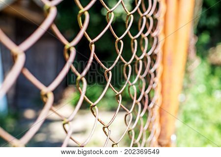 Fence from the old grid. Concept background captivity.