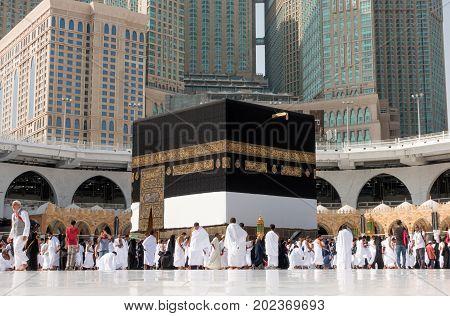 Mecca Saudi Arabia - September 10 2016: Muslim pilgrims put on their white ihrams circling around the holy Kaaba at daytime during Hajj in Saudi Arabia