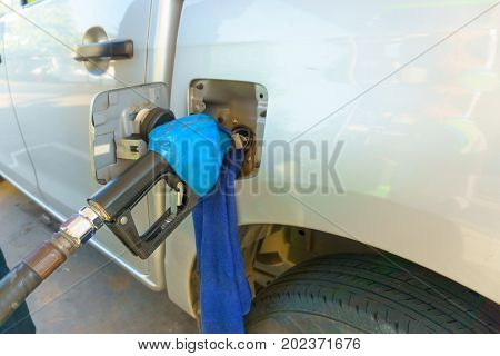 Petrol Pump Nozzle Filling Oil Gas Fuel To The Car