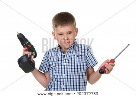 Small cute boy builder in checkered shirt demonstrates the difficulty of choosing a screwdriver, isolated on white background