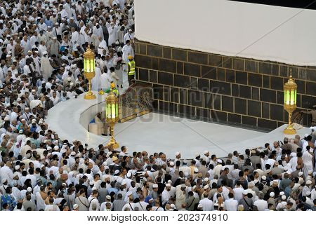 Mecca Saudi Arabia - September 9 2016: Muslim pilgrims put on their white ihrams praying in hijr ismail next to the holy Kaaba during Hajj in Saudi Arabia