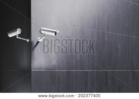 CCTV camera on tile building exterior with copy space. Equipment concept. 3D Rendering